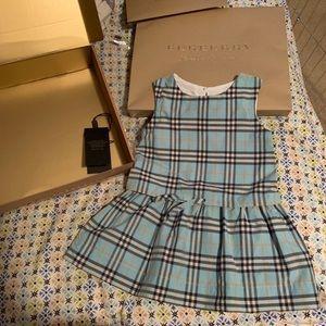 Burberry baby dress.